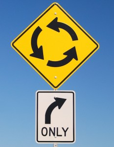 image that shows conflicting road signs